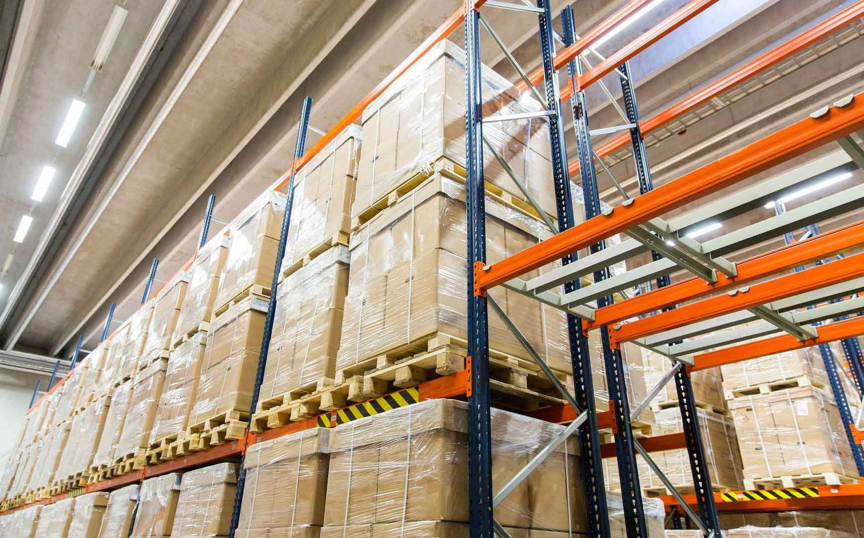 59094848 - logistic, storage, shipment, industry and manufacturing concept - cargo boxes storing at warehouse shelves